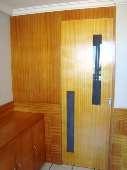 12) Suíte 1 - Closet (entrada)