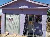 Casa de moradia com garagem.