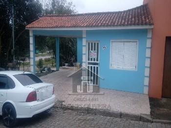 Casa 02 dormitórios garagem Uruguai