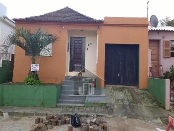 Casa dois dormitórios, garagem bairro Uruguai.