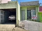 Casa três dormitórios bairro Uruguai.