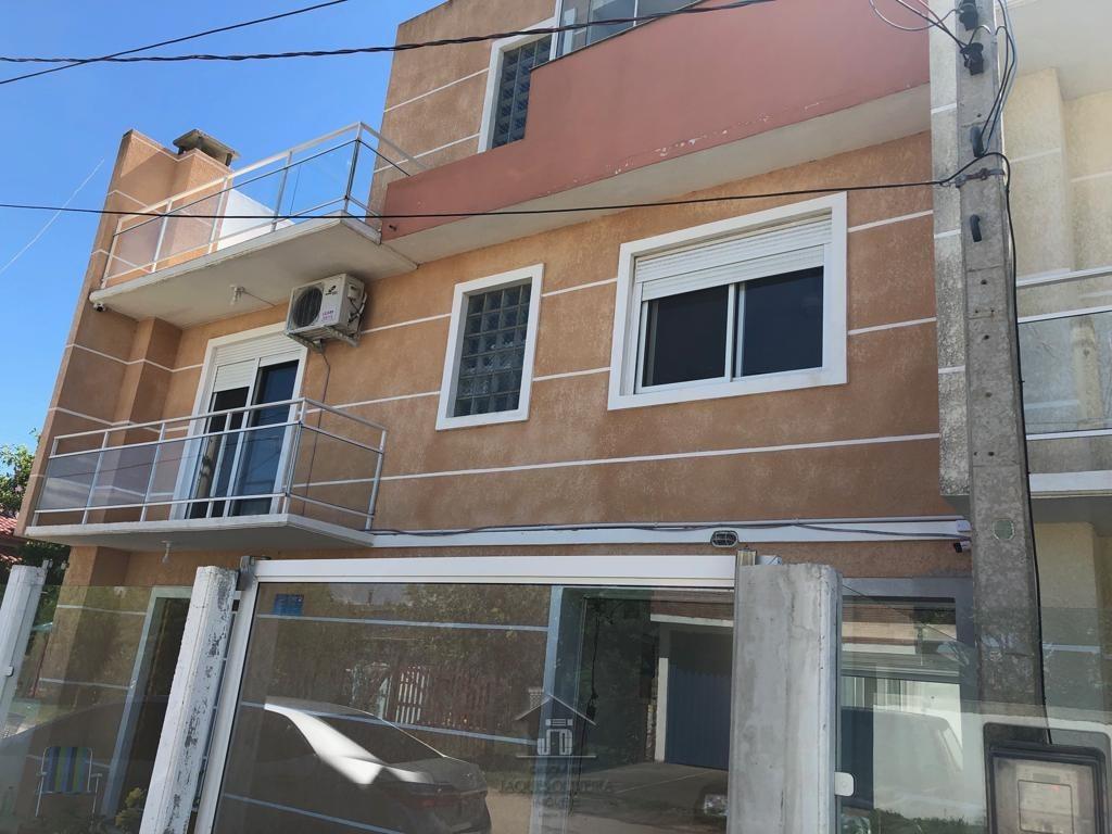 Casa c/ suíte, 02 dormitórios e garagem