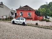 Casa centro 02 dormitórios e garagem