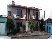 Casa na Vila do Céu com 01 suíte, 02 dormitórios.