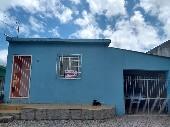 Casa bairro Uruguai, garagem dois dormitórios.