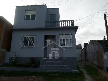 casa bairro Isabel garagem e três dormitórios.