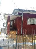 Terreno com 4 casas para renda Penha