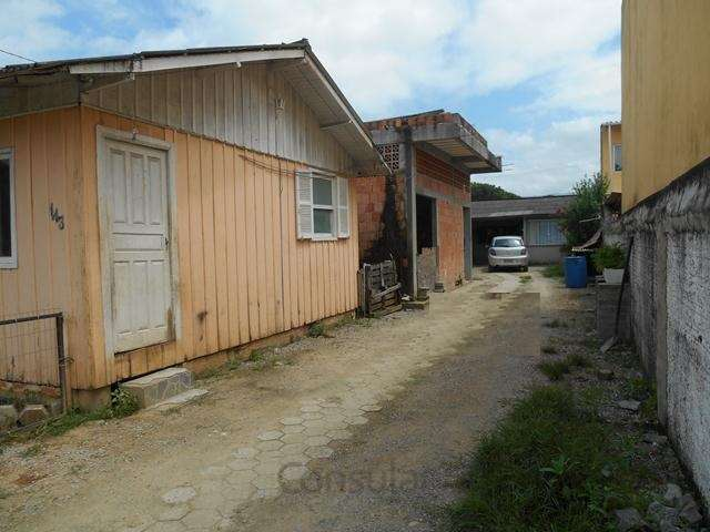 Lote com 2 casas e galpão no Rio Grande