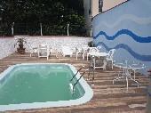 Casa com piscina na Armação