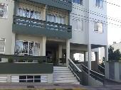 Apartamento no centro com suíte bem localizado