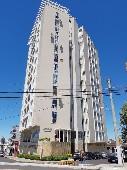 Apartamento no centro com suíte