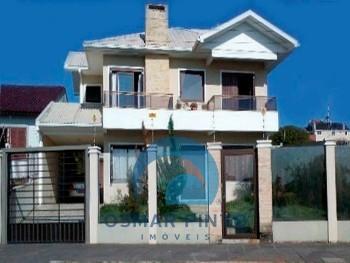 Casa 03 dormitórios em Torres, RS