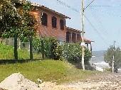 Casa  3 dorm em frente ao mar