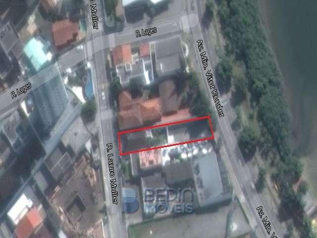 Terreno e casa comercial