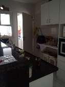vista cozinha e área de serviço
